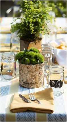 Birch tree trunk, floral centerpieces, green trick dianthus, yellow linens, laid-back wedding design, reception ideas // Justine Ungaro