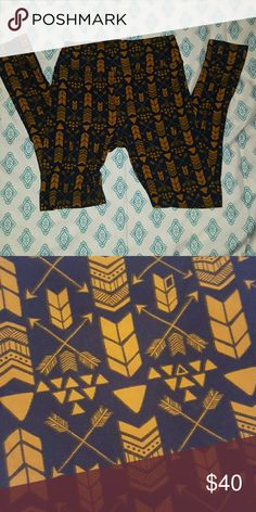 Brand new lularoe arrow leggings Brand new without tags, didn't come with them lularoe leggings  Navy Blue and a golden yellow print LuLaRoe Pants Leggings