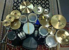 "Pottgeier's DW kit, along with TRX (pronounced ""Turks"") cymbals"