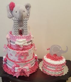 Pink and grey elephant diaper cake and matching table centerpiece.  Check out my Facebook page Simply Showers for more pics and orders. Kim