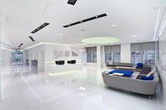 White, high-gloss surfaces, cool sofas and clever lighting create an ultra-cool, ultra-modern meet and greet space for SAS.