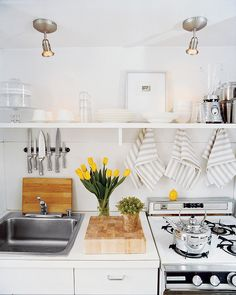 Small, but stylish white kitchen with open shelving