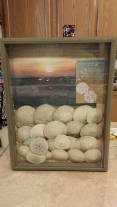 Sand dollars♡    I used a 12x16 shadow box Printed a picture I had of the ocean regular paper size turned it sideways. A postcard of the legend of the sand dollar. Hot glue gunned  about 24 sand dollars. You may want to get as much sand out as possible.
