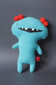 Plush Monster Radetsky with Pom-pom Ears in Coral Red and Turquoise. €20,00, via Etsy.