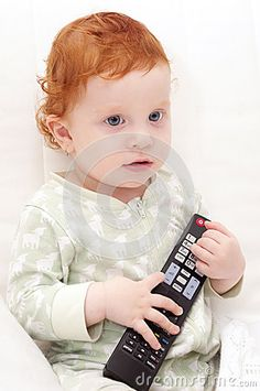 Toddler Baby Watching TV Holding Remote Control