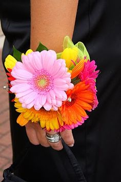 """Julie carried a simple yet bright and vivid bouquet of Aquilega, Roses & Gerberas Natalie, Julie's """"Bridesmaid"""" wore a wrist corsage of Ger. Boutonnieres, Prom Corsage And Boutonniere, Corsage Wedding, Wrist Corsage, Wedding Bouquets, Prom Flowers, Bridal Flowers, Homecoming Corsage, Floral Wedding"""