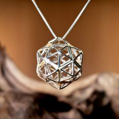 Christ Consciousness - Silver - Sacred Geometry symbol for Healing. Also called - Christ grid pendant This beautiful sacred geometry structure is a combination between two of thePerfect Platonic Solids,theIcosahedronand theDodecahedron.   Each facet of a dodecahedron is actually a pentagon/pentad.  The pentad was so revered to early Greek philosophers and the disciples of Pythagoras that it's construction, and it's divine proportions were kept sec...