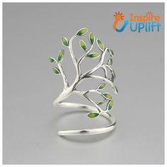 Olive Tree Ring #inspireuplift #AddColor #gift #beautiful #character #dainty #collection #AroundYourFinger #925SterlingSilver #design  Make a truly unique statement with this, Never Before Seen, Olive Tree Ring! This lovely and intricately designed ring is rich in detail and character. Our Olive Tree Ring features a beautiful silver tree that wraps itself daintily around your finger and sweet little green leaves that add color and visual interest. The ring is made with 925 Sterling Silver. This
