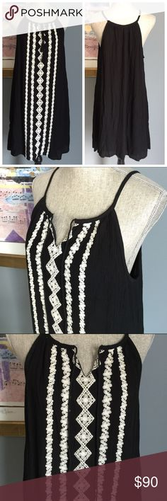 ✨LAST DAY OF SALE✨ Romeo + Juliet Couture Dress Beautiful black & ivory dress from Romeo + Juliet Couture !  Crinkle material with gorgeous crochet stitching down the front w/silver beading added to the center .  Tassel front ties which can be worn tied or dangling for two different looks .  Fully lined .  Made of 100% rayon .  Lining made of 100% polyester . Romeo + Juliet Couture Dresses