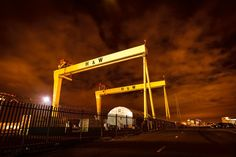 Giants in the sky. The Harland and Wolff cranes in tonight. Photo by Dualta McLaughlin. Bucket List Holidays, Belfast Northern Ireland, Belfast City, Landscape Tattoo, Photography Courses, Days Out, Titanic, Day Trips, Cities