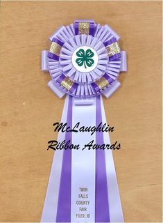 The Winslow Award Ribbon Rosette is completely customizable. It comes standard with custom printing on the center streamer, custom laser printed logo on the center button and you choose the colors. For more information, please call McLaughlin Ribbon Awards at (919) 934-1344 or email info@mclaughlinribbonawards.com #awardribbon #customawardribbon #rosette #rosetteribbon #awards #mclaughlinribbonawards #4Hawards #fairawardribbons #horseshow #dogshow #catshow #rabbitshow #livestockshow Horse Show Ribbons, The Winslow, Custom Awards, Ribbon Rosettes, Showing Livestock, Custom Badges, Custom Printing, Dog Show, Print Logo