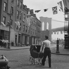 A Father strolling with his child at Lower East Side by the Brooklyn Bridge. New York City, in 1947...this picture just made me smile