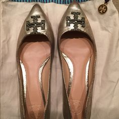Golden Tory burch flats size 38 with dust bag Authentic beautiful Tory burch gold kellen flats ! Super beautiful worn a couple of times but they are too small for me I'm really a side nine they need a good new owner to show them off though they are stunning!!!!:) Tory Burch Shoes Flats & Loafers