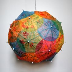 could be fun- cover a balloon w/ paper umbrellas (mod podge or wallpaper paste) dry, cut hole for cord and bulb cute lamp
