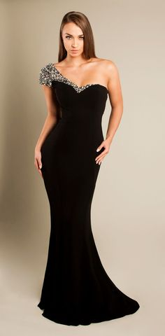 The Diana Dress. A stunning off the shoulder style statement gown for anyone who wants to turn heads. Hand finished with a shoulder encrusted in rhinestones and diamante studs, this piece espouses brilliance and glamour whilst enthralling all those who it passes.