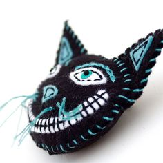 Black Cat pin brooch and ornament, embroidered felt cheshire cat, vintage look, Halloween decor. $16.00, via Etsy.