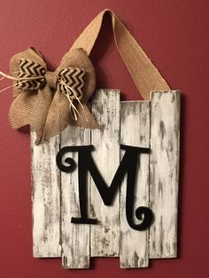 Handcrafted from pinewood, these signs come stained or distressed, with your choice of block or script letter monogramming You choose the letter and bow color. The dimensions of this plaque are approximately 17 x 14 inches. It will hang nicely from a wreath hanger on your door. Because each of our pieces is hand cut from wood that can have a rough texture, knots, small cracks or other imperfections that add to its rustic nature, painted with paints mixed right on the piece, and hand…