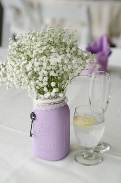 a simple bunch of babies breath in a lavender painted mason jar