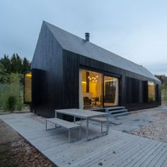 Format Elf Architekten adds blackened timber  cottages to a rural German resort