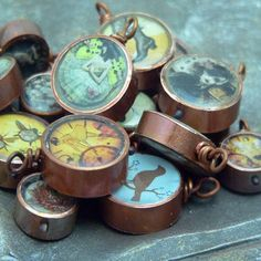 These are really cool, made with sections of copper pipe - the images are backed with polymer clay and sealed with resin