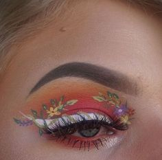 Peach pink eyeshadow with white winged liner and little painted on flowers. Super arsty eye look, perfect for makeup inspo.