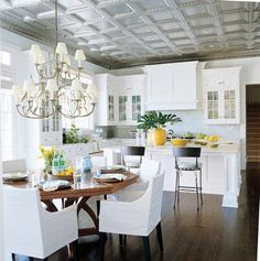 This kitchen from Christopher Peacock Cabinetry's Scullery Collection was designed for a client in the Hamptons. It is painted in Scullery White from Christopher Peacock Paint.