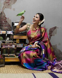 South Indian bride. Temple jewelry. Multicoloured silk kanchipuram sari. Braid with fresh flowers. Tamil bride. Telugu bride. Kannada bride. Hindu bride. Malayalee bride.