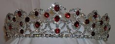 The Scarlet Royal Empress Rhinestone Beauty Pageant Queen, Princess, Crown Tiara For a romantic and elegant look in a tiara, this design is both versatil and charming. The tiara is adorned with red st