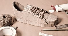 adidas Originals handcrafted from cardboard by chris anderson of Ando Illustrates: the scale model sneakers feature interpretations of the superstar shelltoe, campus and the tennis classic stan smith shoe.