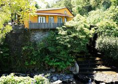 23 mei 2020 - Gehele woning/appartement voor As annex of an former water mill, this small guest house is located directly above the river. Surrounded by lush vegetation, with view over the val. Water Mill, Lush, Portugal, Cabin, River, Vacation, House Styles, Home Decor, Saint Michael