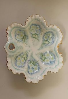 Trinket Nut Dish Porcelain Floral Scalloped Gold Trim Edge Hand Pained 80's Vintage Blue Green Vintage by TallulahsVintage on Etsy https://www.etsy.com/listing/385734002/trinket-nut-dish-porcelain-floral