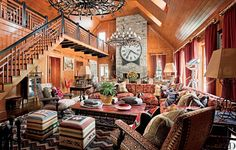 The dramatic ceiling height of the Allan Greenberg–designed guesthouse's great room on the grounds of this Connecticut estate, allowed interior designer Scott Salvator to choose large-scale pieces—a 19th-century clock face and 84-inch-diameter chandeliers—to complement the space. The sofa and club chairs are from Avery Boardman, the ottomans are from Linda Horn Antiques, and the candelabra is Ralph Lauren Home.