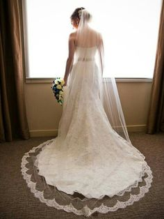 {Bridal Portrait Of A Beautiful Bride In Her Strapless, Beaded Lace Wedding Gown With Court+ Length Train, & Cathedral Veil Featuring Beaded Lace Trim/Edging}
