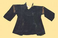 Hegira 3rd–4th centuries / AD 9th–10th centuries, Abbasid  Linen embroidered in wool  Bardo Museum  Tunis, Tunisia  About the Museum    The shape of this linen tunic, dyed black and undoubtedly intended for a child, is reminiscent of Coptic clothes. Each sleeve is decorated around the shoulders slightly differently from the other with plant and floral elements mixed with stylised zoomorphic motifs.