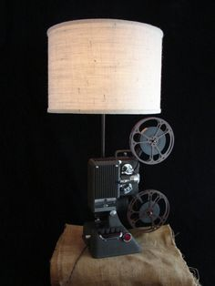 Vintage projector (with film reels!) repurposed as a lamp. This would look great in many rooms.