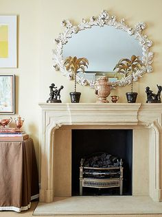 We love the look of a rococo plaster or baroque gilt Italian frame for a traditional interior above the fireplace.