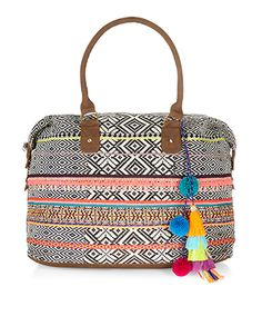 Category: Bags > Weekender Bags Hit the road in style with this tribal woven weekend bag, with colourful pom-pom and tassel charms, embroidered details and leather-look handles. Perfectly-sized for mini break essentials, this practical piece features a zip-top closure, and a detachable and adjustable shoulder strap. Colour: Multi