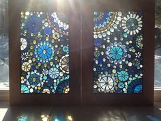 Erin Haworth - Artist Shop can be found on http://www.etsy.com/shop/lowlightcreations?ref=seller_info    Beautiful Shades of Blue and Gold Glass on Glass Mosaic Window Panel Circles
