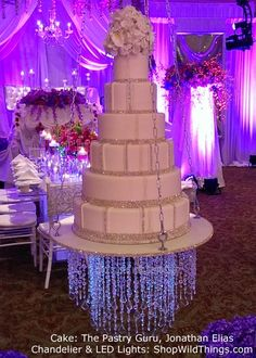 "Suspended Wedding Cake with a ""Dazzle"" Crystal Chandelier hanging underneath! To. Die. For."