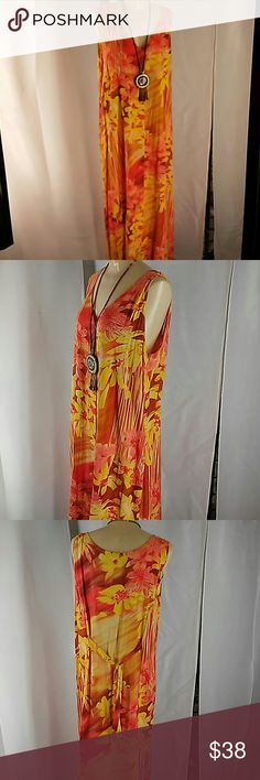 Jams World Sundress 100% Rayon Made in Hawaii USA. You can almost smell the flowers on this Dress! Size XL. It has buttons down the entire dress.  It also has pockets in side seams of dress. It could be worn open like a duster over mono chrome slacks and tank or camisole. It is a very versatile piece of clothing. Own a piece of Paradise. Jams World Dresses Maxi