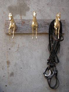 Gold Breyer horses on reclaimed wood