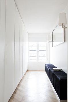 Walk-in closet. Appartement Poissonniere by Frederic Berthier Architecture. Hallway Cupboards, Hallway Storage, Wall Storage, Ceiling Storage, Cupboard Doors, Shoe Storage, Walk In Closet Design, Closet Designs, Apartment Interior Design