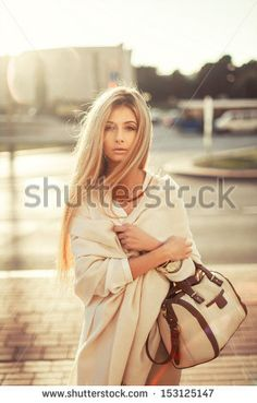 stock-photo-young-woman-pretty-fashion-outdoor-portrait-in-the-city-evening-soft-sunlight-153125147.jpg (300×470)
