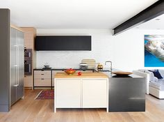 Designer Connie Braemer used a mix of unique cabinetry styles and materials to craft a one-of-a-kind kitchen. Light Wood Kitchens, Light Wood Cabinets, Kitchen Cabinets, Open Concept Kitchen, Kitchen Layout, Kitchen Decor, Kitchen Ideas, Kitchen Inspiration, Wooden Kitchen