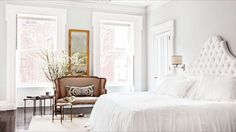 clean crisp white bedroom with antiques