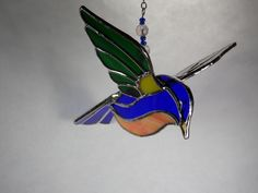 stained glass bird 3D painted bunting about 5 inches long.At Jitter Beans. Mineral Wells Texas