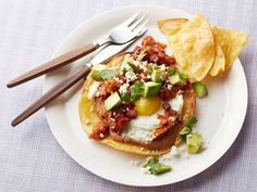 Jamie's Huevos Rancheros : Make a Mexican-inspired meal that's on the lighter side. Serve corn tortillas smothered in homemade salsa, chorizo, beans, avocado, eggs and cheese.