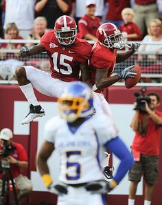 Darius Hanks and Marquis Maze celebrate Maze's touchdown grab behind defender Alex Germany during Alabama's victory over San Jose State.