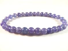 Tanzanite Stretch Bracelet High Quality 6mm Smooth Round Tumbled Bead Violet Flame Gemstones by SandiLaneFineArt on Etsy