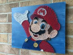 A personal favorite from my Etsy shop https://www.etsy.com/ca/listing/523328542/string-art-super-mario-nintendo-gamer